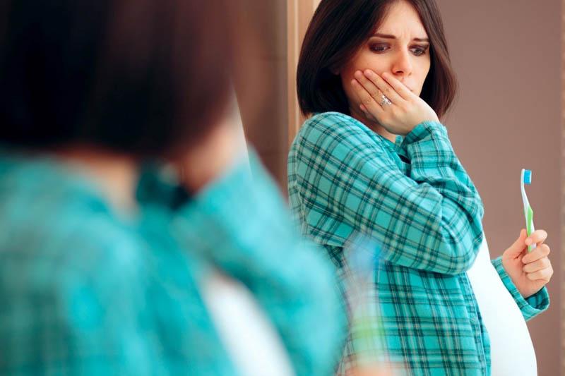 Hiện tượng ê buốt răng ở bà bầu có nguy hiểm không?